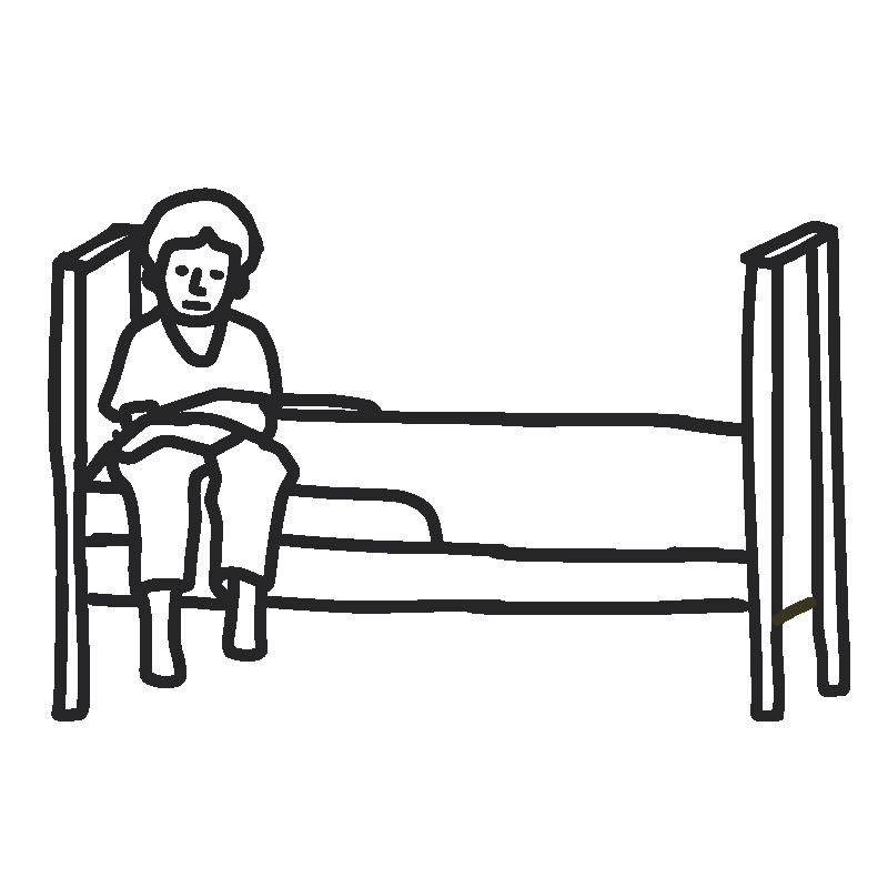 Sad boy sitting on his bed
